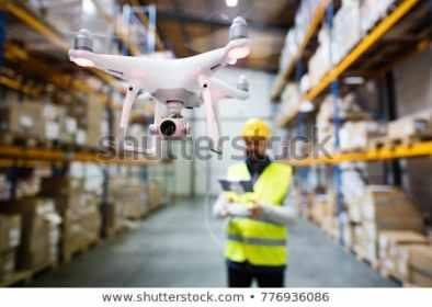 man-drone-warehouse-450w-776936086