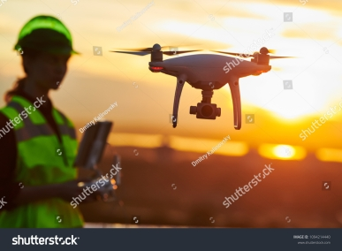 stock-photo-drone-inspection-operator-inspecting-construction-building-site-flying-with-drone-sunset-1094214440