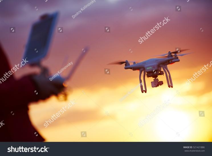 stock-photo-drone-pilotage-at-sunset-521421886