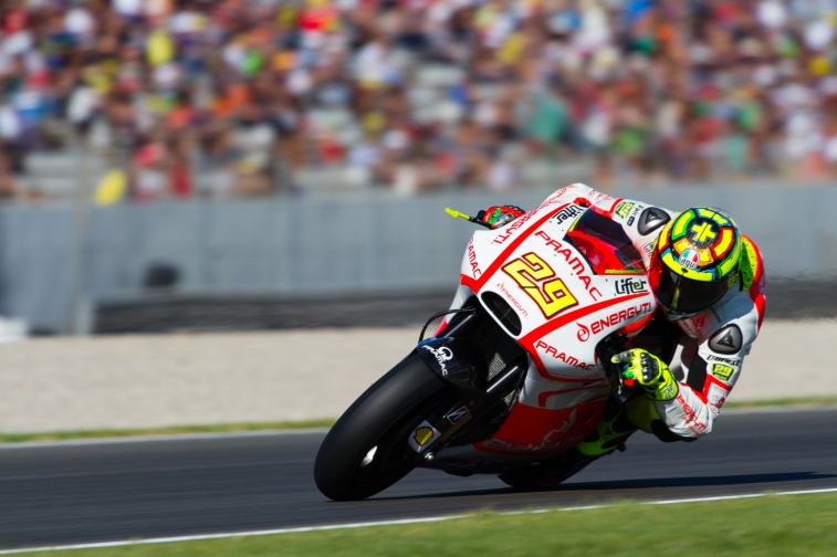 Andrea Iannone during the Moto GP Grand Prix Generali Comunitat Valenciana qualifying session at Circuit de la Comunitat Valenciana Ricardo Tormo on November 9, 2013 in Valencia, Spain. (Photo by GinŽs Romero/Madrid Photosport)